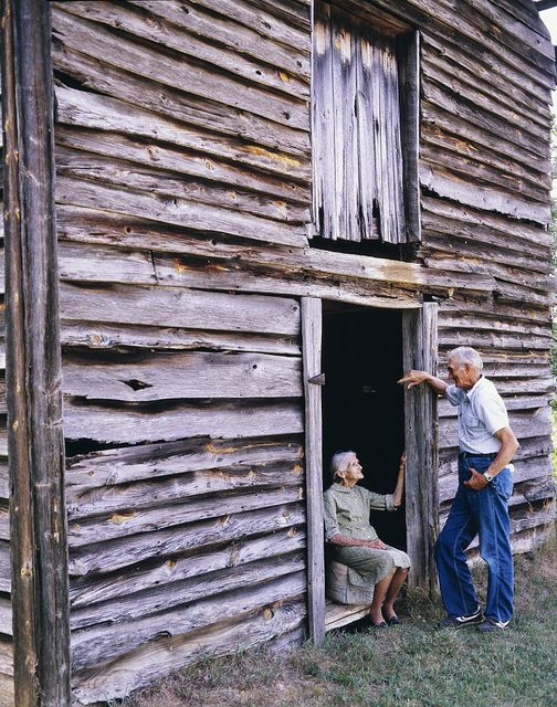 Kate Carter sitting at a barn door on the farm where Carol Highsmith's grandfather and great-grandfather were born in Wentworth, North Carolina
