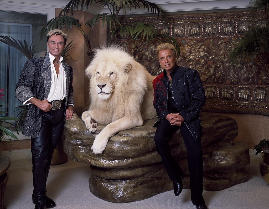 Las Vegas illusionists Siegfried (right) & Roy, and a large feline friend, in their Mirage Hotel and Resort apartment, prior to Roy's career-crippling mauling by a white tiger during one of their performances. Las Vegas, Nevada
