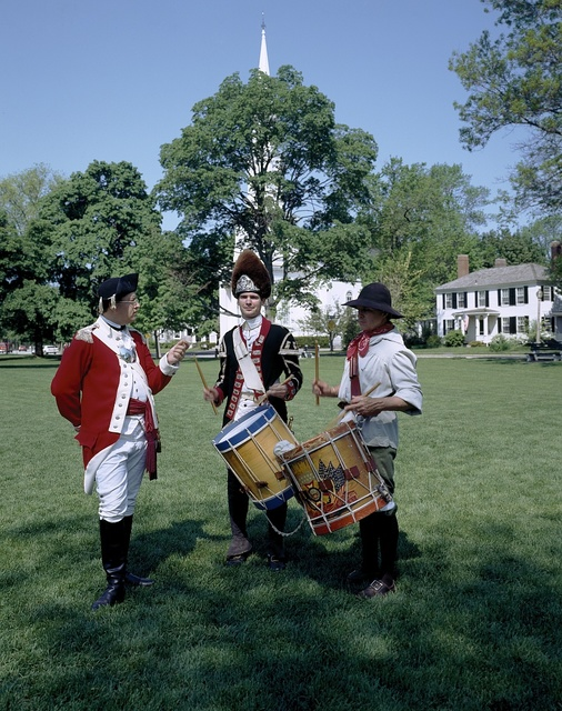 Lexington citizens dress as colonists or British troops on the green in Lexington, Massachusetts