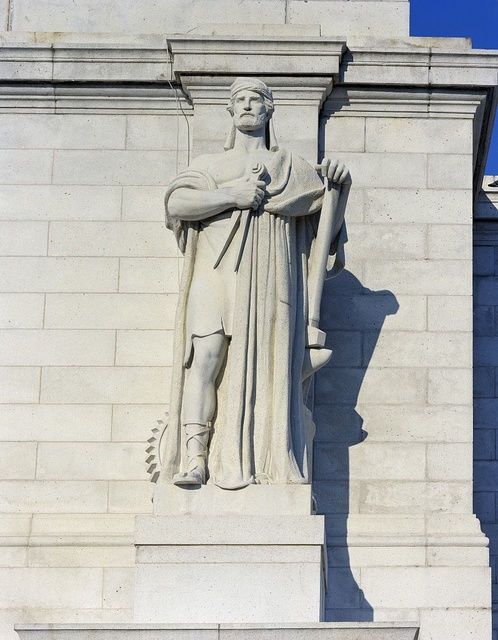 Louis St. Gaudens's allegorical Archimedes statue, representing the gift of mechanics, one of six on the parapet above the entrance to Washington D.C.'s Union Station