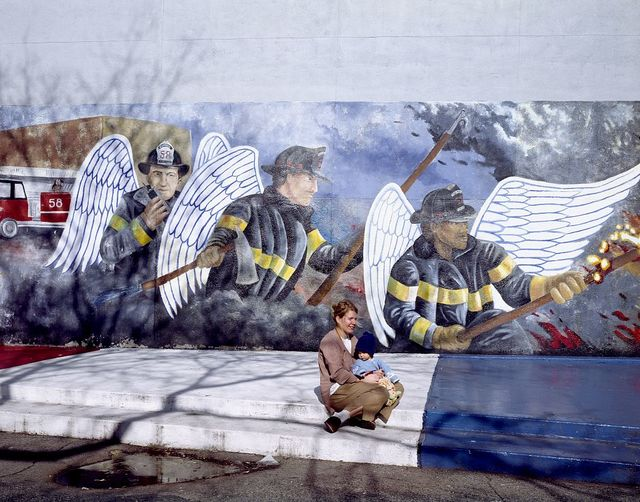 Mother and child at the Chicago firefighter mural, Chicago, Illinois