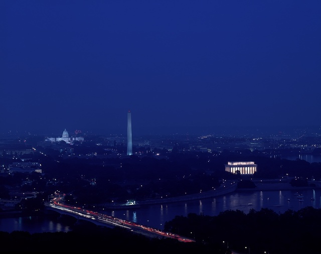 Nighttime view of monumental Washington, showing (right to left) the Lincoln Memorial, Washington Monument, and U.S. Capitol