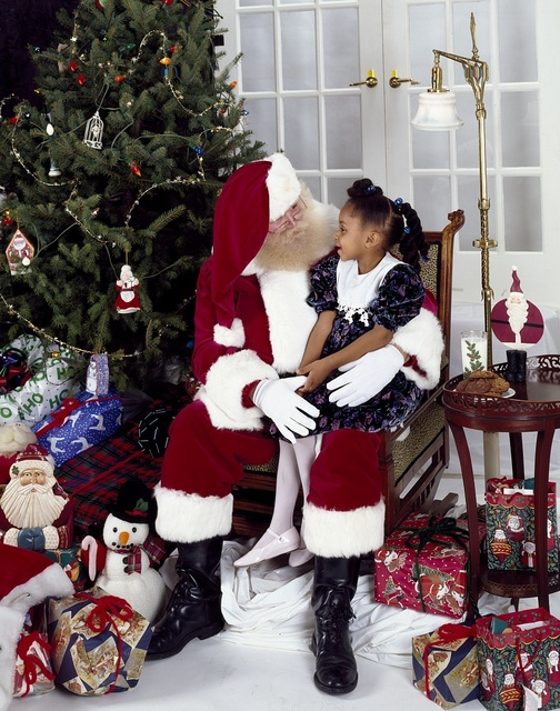 On a pre-Christmas visit to Carol Highsmith's studio in Washington, D.C., Santa Claus gets a wish list from a little girl