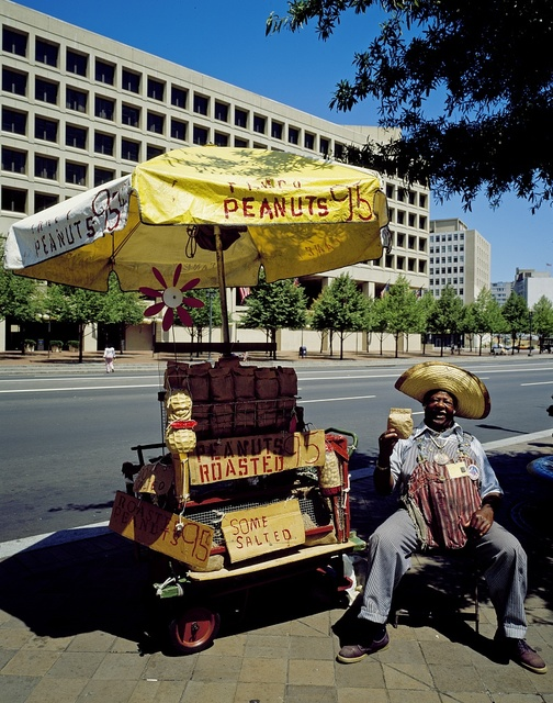 Peanut vendor sells peanuts on Pennsylvania Avenue in Washington, D.C. during the 1980s