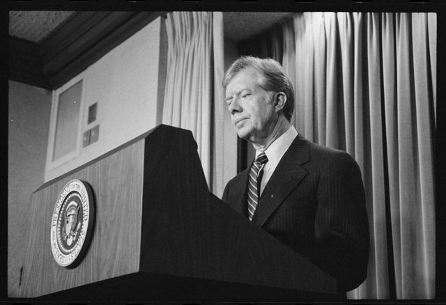 [President Jimmy Carter announces new sanctions against Iran in retaliation for taking U.S. hostages]