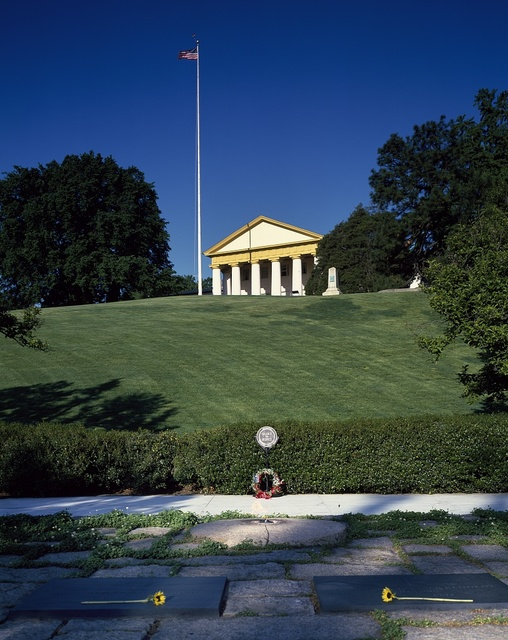 Robert E. Lee's Arlington House stands high above the Kennedy family gravesite at Arlington National Cemetery, Arlington, Virginia
