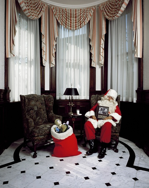 Santa Claus drifts off while reading about Abraham Lincoln, whom Mathew Brady photographed in the same building on Pennsylvania Avenue, Washington, D.C.