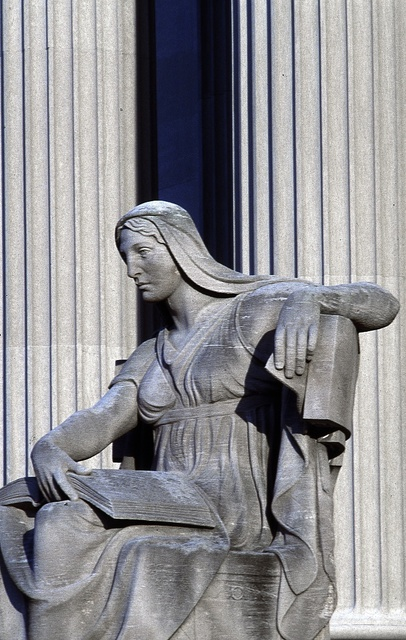"""Sculptor Robert I. Aitken's statue, """"The Future,"""" completed in 1935, sits on the Pennsylvania Avenue side of the National Archives Building, Washington, D.C."""