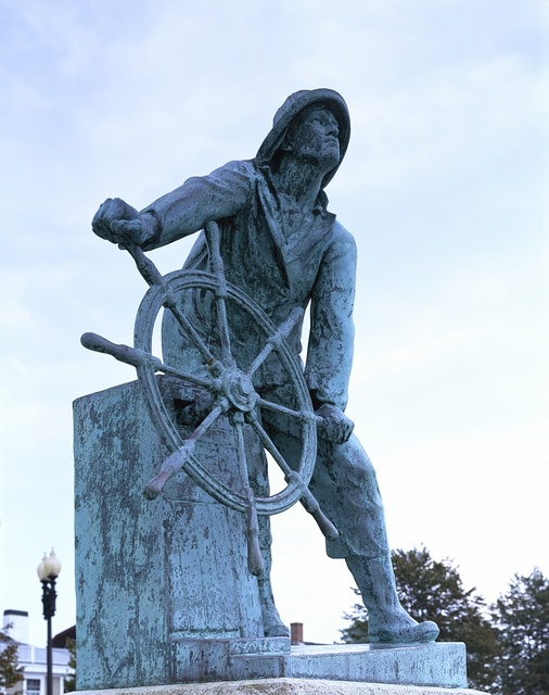 [Sculpture of Sailor with ship's wheel]