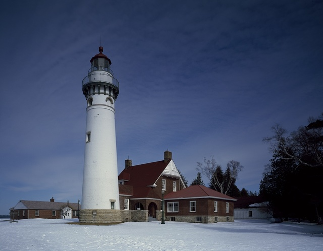Seul Choix Point Lighthouse on Michigan's upper peninsula helps guide boaters through the dangerous Straits of Macinaw. Gulliver, Michigan