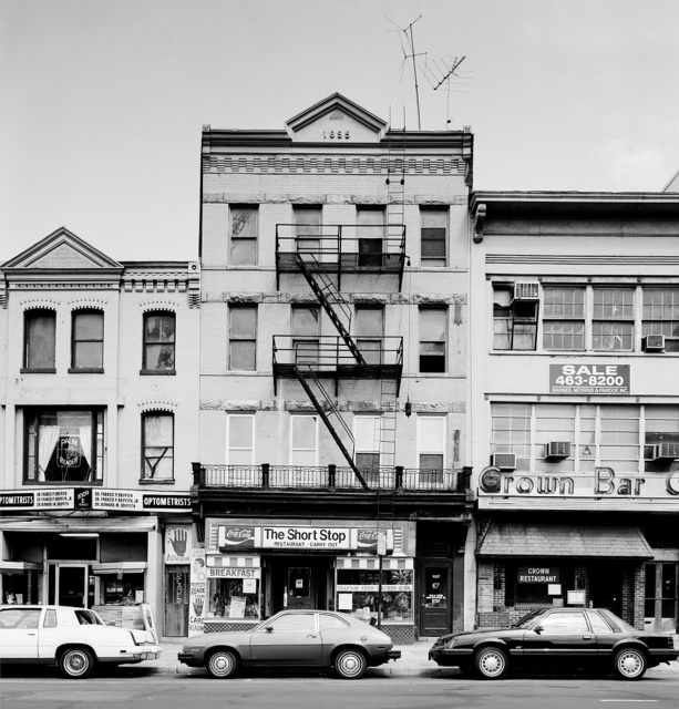 Short Stop Restaurant, Crown Bar, and retail stores at 11th and E Streets, N.W., Washington, D.C., photographed before they were demolished to make way for new buildings