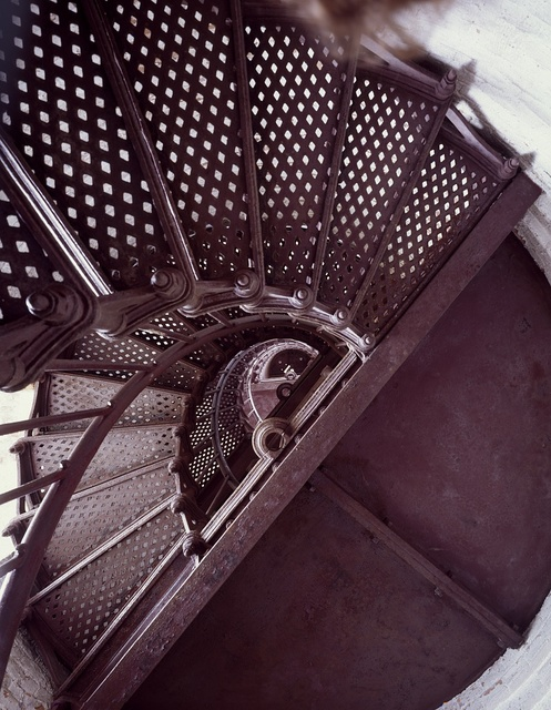 Spiral staircase at Thirty Mile Point Lighthouse overlooking Lake Ontario in Golden Hill State Park, Barker, New York