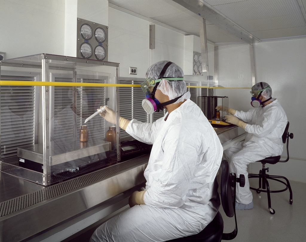 Technicians at a pharmacutical company laboratory, Rockville, Maryland