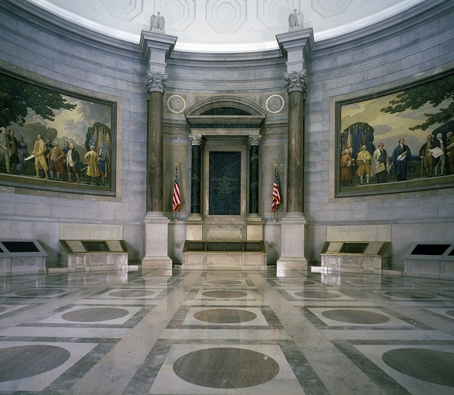 The dimly lit hall at the National Archive where the Charters of Freedom, the U.S. Constitution and Declaration of Independence, are displayed. Washington, D.C.