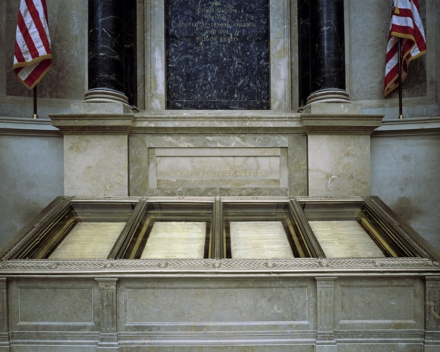 The nation's founding documents displayed under subdued light at the National Archives, Washington, D.C.