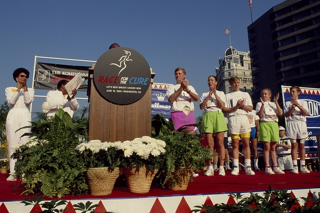 Vice President Dan Quayle and Second Lady Marilyn Quayle, to the right of the podium, at a Race for the (Cancer) Cure run in 1990, Washington, D.C..