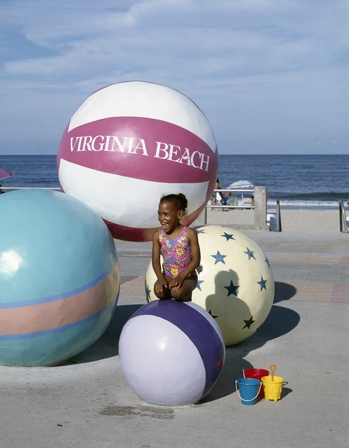 Young Virginia Beach enthusiast at one of the beach community's many public-art displays, Virginia Beach, Virginia