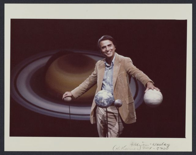 Carl Sagan with the planets