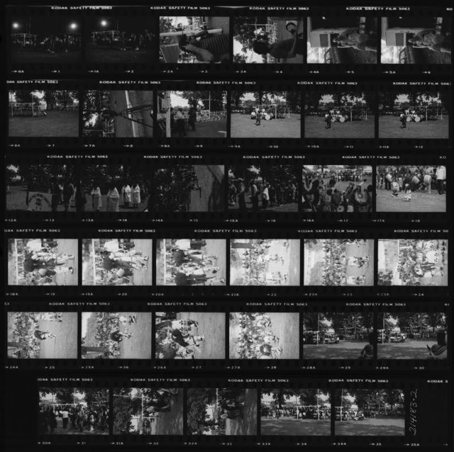 Contact Sheet: 1-2 Special;  3-4 Mike McCauley Listens to Recording Made Sunday Afternoon; 5-6 Maria La Vigna at Entrance to Her Camper; 7 Drums and Shed; 8 Nebraska ETV Camera; 9 Clifford Wolfe, Sr.; 10-12 Carl Fleischhauer and Host Drum; 13-16 Grand Entry; 17 Boys on Bench;  18-28 San Juan Pueblo Buffalo Dance;  29-35 Special for John Turner