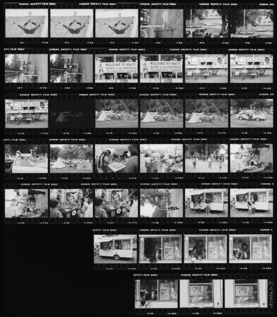 Contact Sheet: 1-3 Stereo Mike Pair for Host Drum; 4 Extra Microphone at Center of Arena; 5-6 Cables and Microphone Stand Used As Telephone Cord to Run Three Cable Sets to Center of Arena; 7-8 Microphone Cable Run and Extra Microphone in Singers' Area; 9-13 Charlie Edwards in Front of the Speaker Stand; 15-17 Boys Playing Football in Campground to West of Arena; 18-20 In the Campground; 21-22 Crafts Table; 23 Midway; 24-27 Photo Button Stand; 29-37 Food Stand