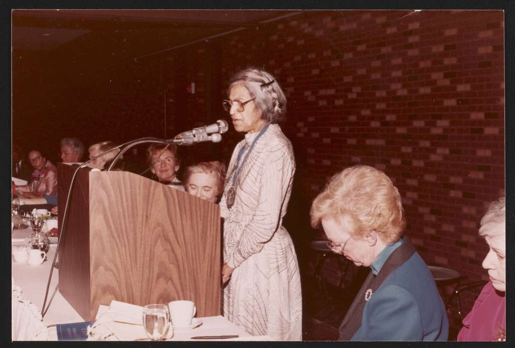 Rosa Parks, wearing medal, speaking at award ceremony, Detroit, Michigan