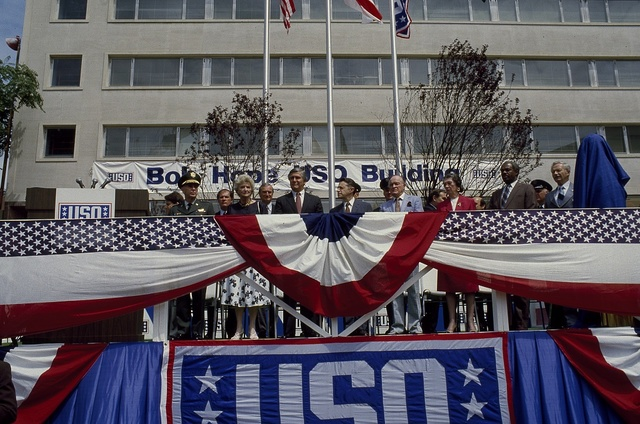 "Dedication on May 30, 1985 of the USO headquarters building as the ""Bob Hope Building,"" in honor of comedian Bob Hope (light blue jacket), Washington, D.C."