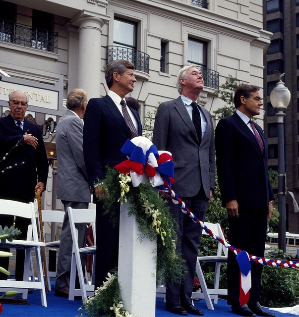 Oliver Carr, left, president of the firm that renovated the historic Willard Hotel, waits to speak at its reopening in 1986. To his right is U.S. Senator Daniel Patrick Moynihan, a driving force behing the restoration of much of historic Pennsylvania Avenue on which the Willard is located in Washington, D.C.