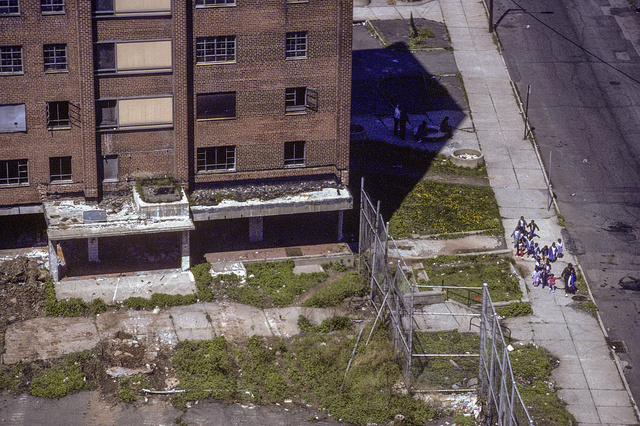 Children walking by the ruins of the Scudder Homes, Court St. by Broome, Central Ward, Newark, 1987
