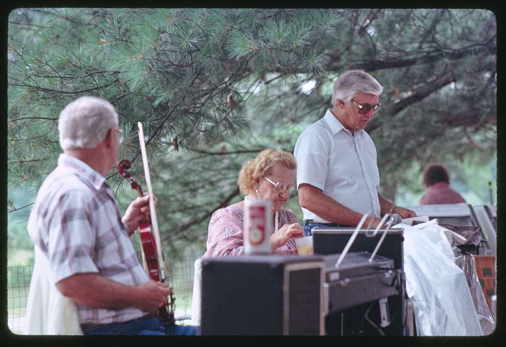 Wilson Langlois, Corinne Foster, Ray Paquin, Yvonne Lagasse, Mr. and Mrs. Kelly, and Madeline Osorio playing music and dancing, Lowell, Massachusetts