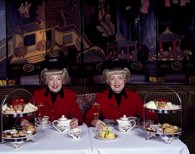 San Francisco, California's most famous twins, Marian (left) and Vivian Brown, photographed in the 1990s, enjoy afternoon tea