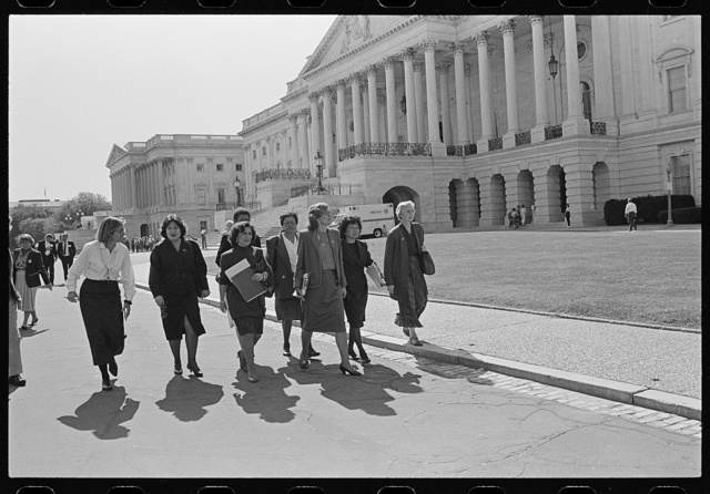 [U.S. Representatives including Nita Lowey, Pat Schroeder, Patsy Mink, Jolene Unsoeld, Eleanor Holmes Norton and Ileana Ros-Lehtinen walking by the U.S. Capitol on their way to the Senate]