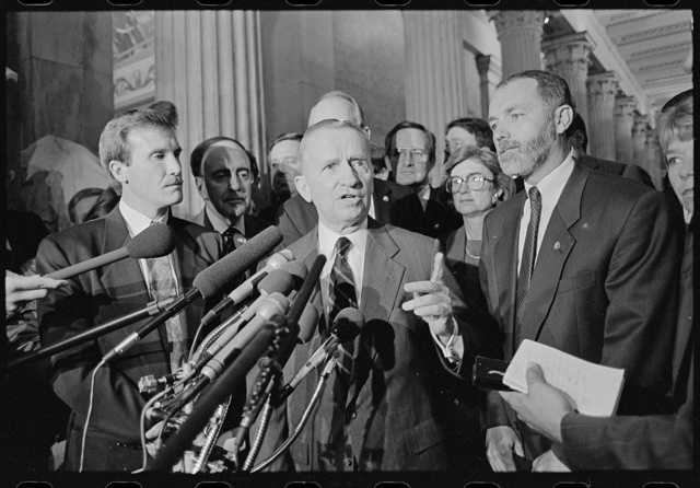 [Businessman Ross Perot with Republican freshmen Congress members speaking at a press conference in the U.S. Capitol]
