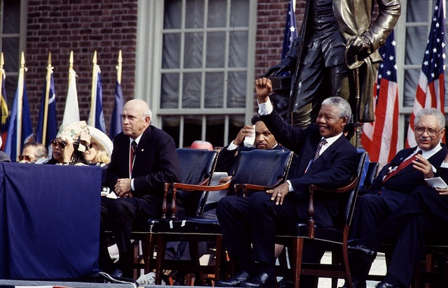 F.W. de Klerk, left, the last president of apartheid-era South Africa, and Nelson Mandela, his successor, wait to speak in Philadelphia, Pennsylvania