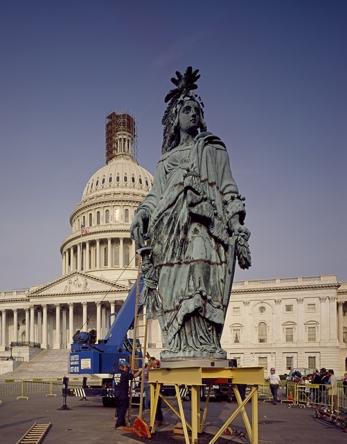 In 1993, Thomas Crawford's Statue of Freedom was removed by helicopter from the U.S. Capitol dome for restoration. Washington, D.C.
