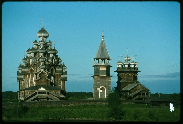 Pogost ensemble, Church of the Transfiguration (1714) (left); bell tower (19th century); Church of the Intercession (1764), west view, evening, Kizhi Island, Russia