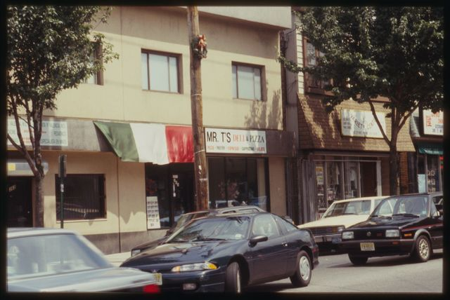 A view of 21st Avenue.  The Italian flag is hung over the entrance to one of the many Italian-owned and -operated cafes on the avenue.