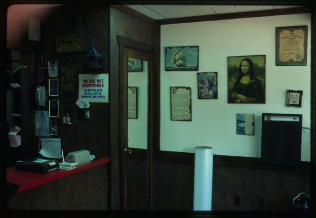 A view of the east wall of the shop, with memorabilia hung there.