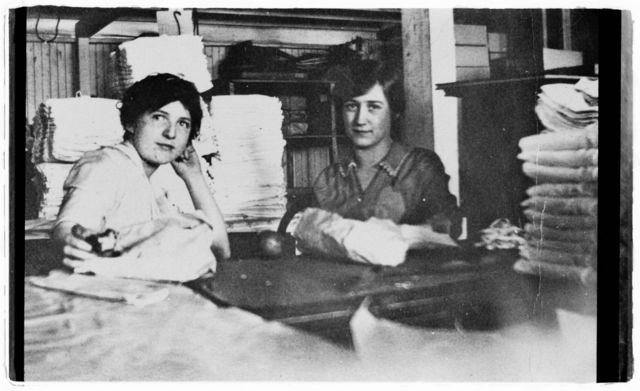 Anne Murphy (left) and co-worker in the packing room at Newberger's Towel Factory.