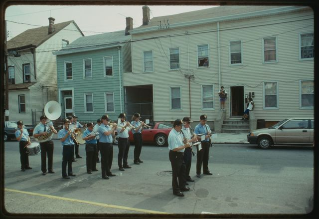 Band plays in street in front of church.