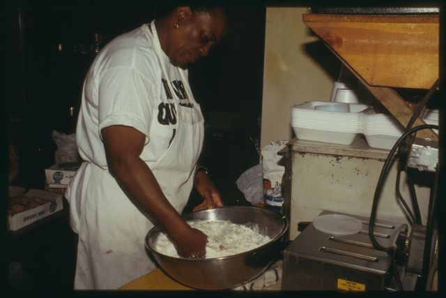 Benson stirs biscuit batter.