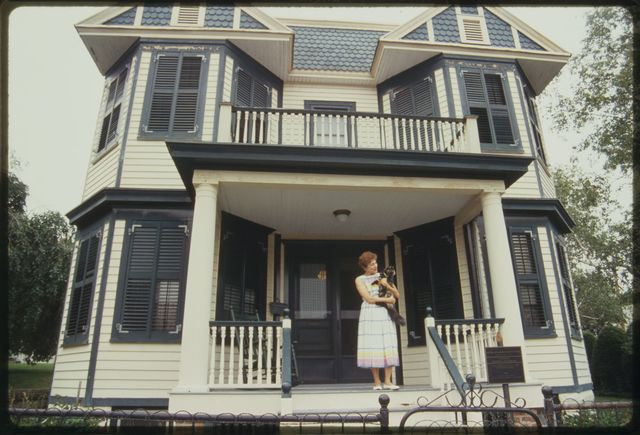 Bunny Kuiken, granddaughter of Pietro Botto, stands in front of Botto House.
