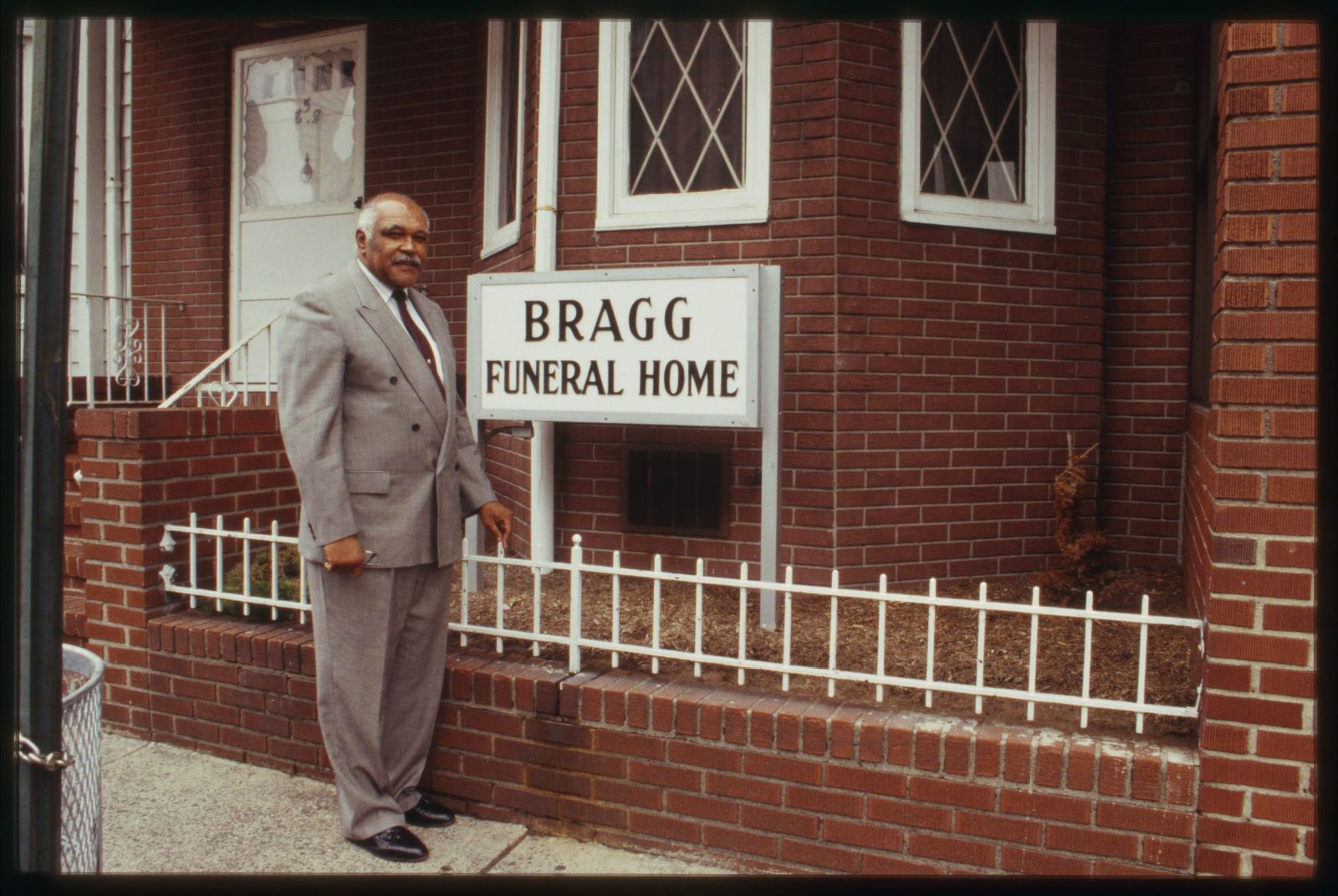 Carnie Bragg Owner Of Bragg Funeral Home Poses In Front Of The