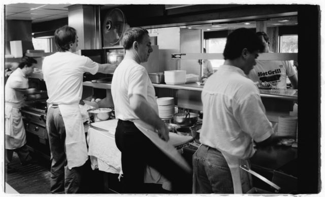 Cooks at work on the Hot Grill preparation line during the lunch rush.