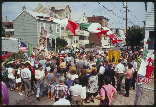 Crowd of people in Lewis Street, between float carrying statue of San Rocco and the front of the Montescaglioso Club.
