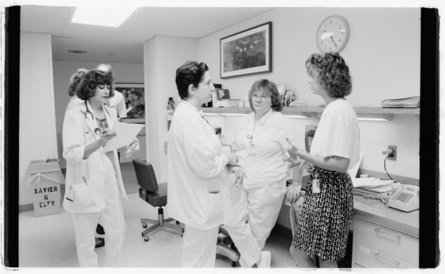 Doctors and nurses at the Oncology nurse's station, 4th floor.