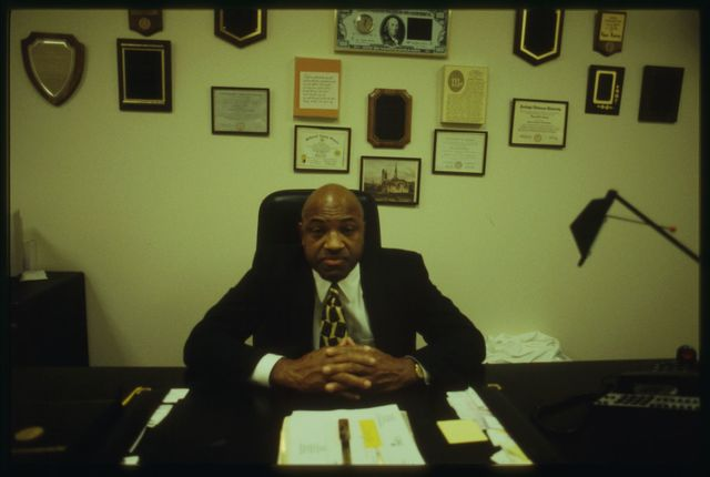Ed Ramsey, owner of Sweet Potato Pie Company, at his desk.