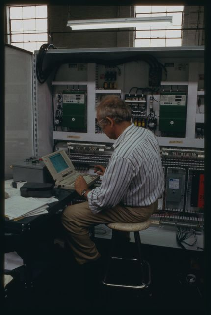 Electrical engineer Ernest Milov installing a laptop computer into the take-up panel to evaluate the circuits.