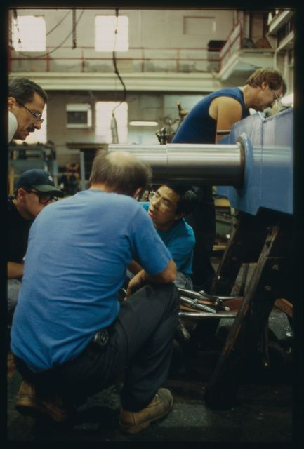 Electrician Bob Dale, engineer Guosheng Lu, apprentice Jim McComiskey and assembler Pete Wychman working on a rotary take up.