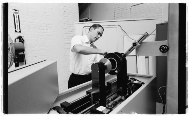 Engineer Tom McComiskey running demonstration of the proof tester developed through Peachtree, a Watson subsidiary involved in fiber optics.
