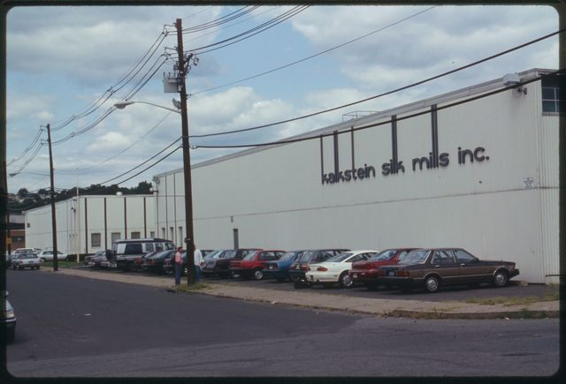 """Exterior (front) of main mill building; """"Kalkstein Silk Mills, Inc."""" is on the wall."""